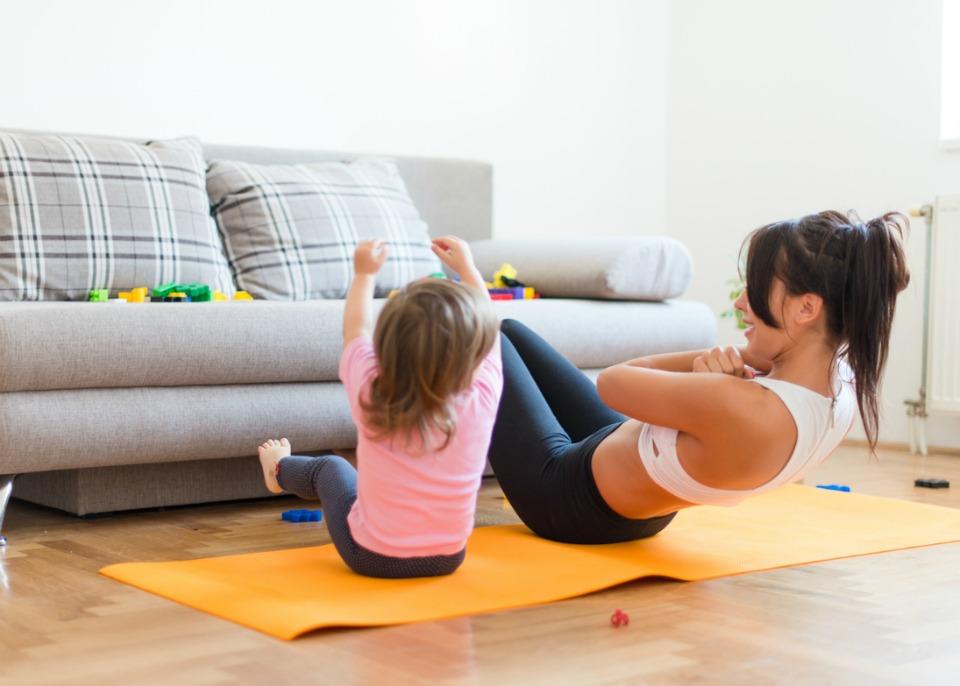 Mum exercising with daughter