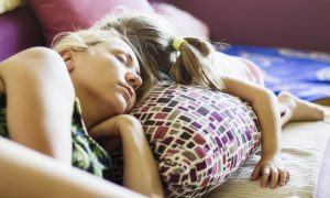 Mother and daughter are sleeping on a couch in the afternoon. AdobeRGB profile.