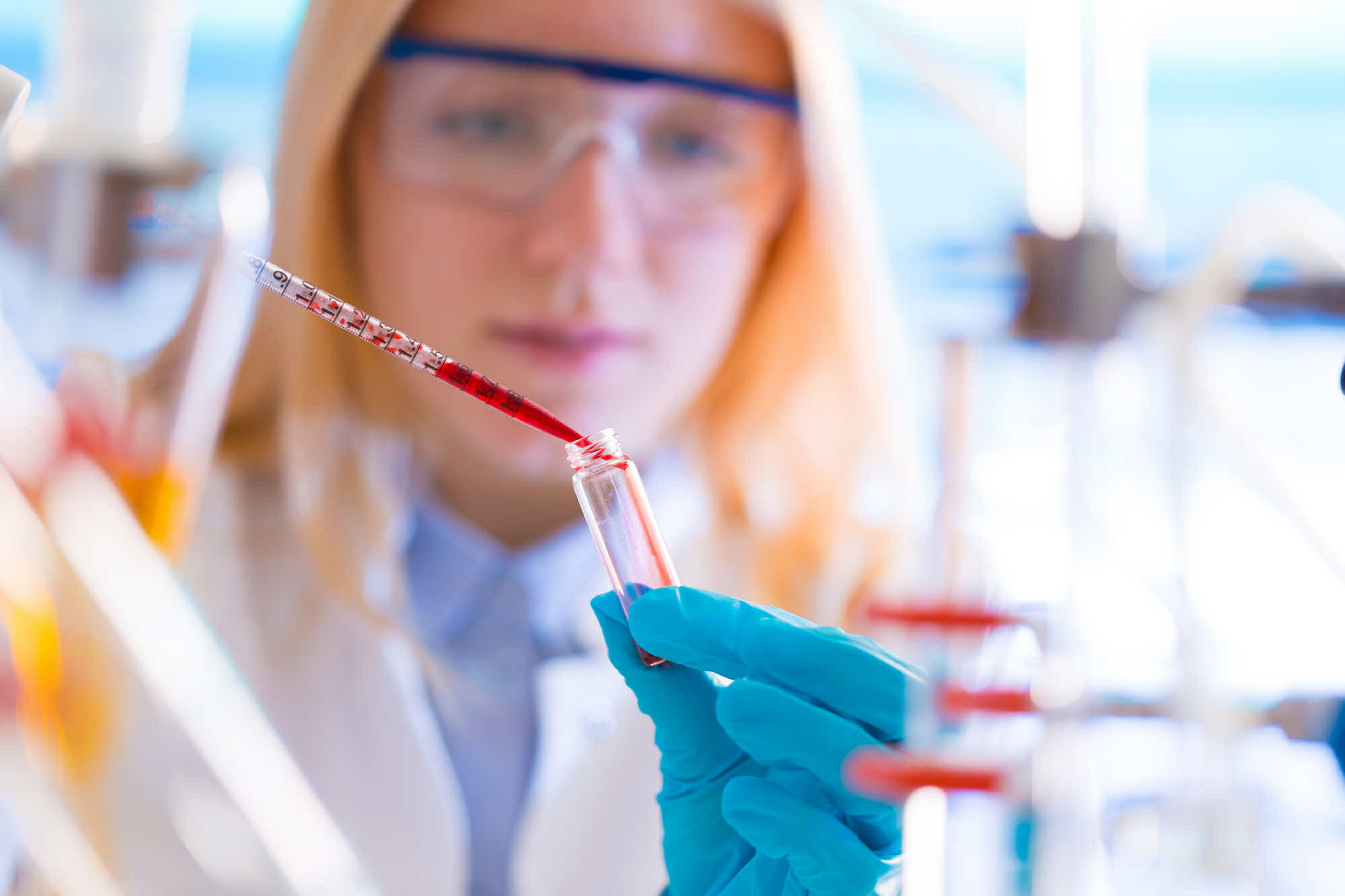 Girl with a pipette in a lab University Hospitalfood quality control